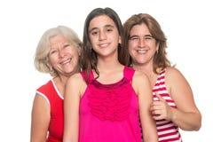 Family of hispanic women isolated on white. Three generations of hispanic women isolated on a white background Stock Photos