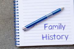 Family history write on notebook. Family history text concept write on notebook with pen royalty free stock photo