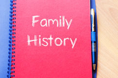 Family history write on notebook. Family history text concept write on notebook with pen royalty free stock image