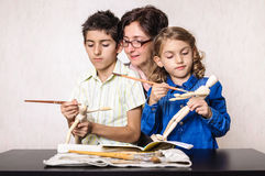 Family hobby mother boy and girl painting Royalty Free Stock Photo