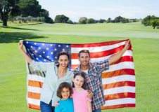 Family holding an american flag in park Royalty Free Stock Image