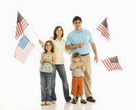 Family holding American flags. Royalty Free Stock Photo