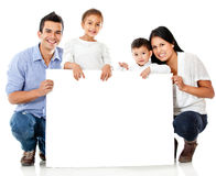 Family holding a banner Stock Photo