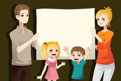 Family holding a blank paper Stock Photography