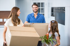Family holding box while relocating Stock Images
