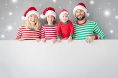 Family holding cardboard banner blank stock photo