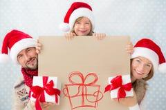 Family holding Christmas banner Stock Photos