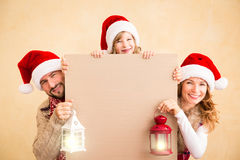 Family holding Christmas banner Stock Photography
