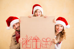 Family holding Christmas poster Stock Images