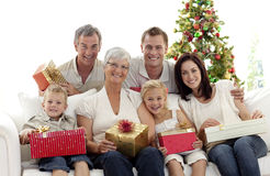 Family holding Christmas presents at home Royalty Free Stock Photography