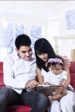 Family holding a digital tablet Stock Photos