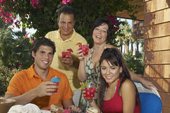 Family Holding Drinks Together Stock Image