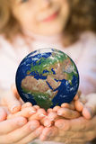 Family holding Earth planet Royalty Free Stock Photography