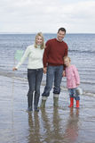 Family Holding Fishing Net And Bucket On Beach Royalty Free Stock Image