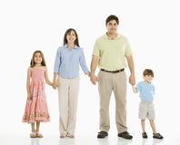 Family holding hands. Hispanic family of four standing against white background holding hands