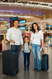 Family holding hands at airport Royalty Free Stock Photos