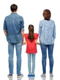 Family holding hands from back on white background. Family and people concept - mother, father and little daughter holding hands over white background from back royalty free stock images