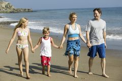 Family Holding Hands on Beach Royalty Free Stock Photography