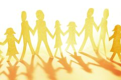 Family holding hands. Family paper chain cutout holding hands Stock Photo