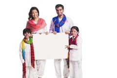 Family holding a placard Royalty Free Stock Images