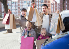 Family holding shopping bags Royalty Free Stock Photos
