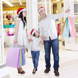 Family holding shopping bags at mall Stock Image