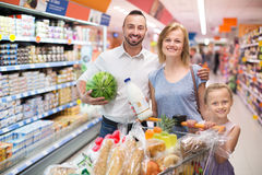 Family holding shopping Stock Photos