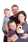 Family holding small house Stock Photo