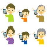 Family holding smartphone Stock Image