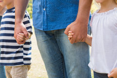 Family holding their hands. On a sunny day Stock Image