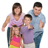 Family holding their thumbs up. On the white background Royalty Free Stock Images