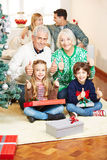 Family holding thumbs up at christmas eve Royalty Free Stock Photo