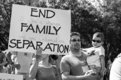 Family Holds Sign to End Family Separation at Immigration Rally. Immigration Rally held in Columbus Ohio on 06/30/18. Part of the nationwide rallies to protest royalty free stock images