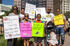 Family Holds Signs to End Family Separation at Immigration Rally. Immigration Rally held in Columbus Ohio on 06/30/18. Part of the nationwide rallies to protest stock photography