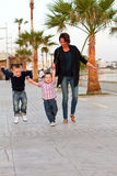 Family on holiday. Mum and two sons walking on holiday Royalty Free Stock Photo