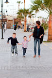 Family on holiday. Mum and two sons walking on holiday Stock Image