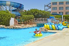 Family holiday in aquapark. Family vacation. royalty free stock photography