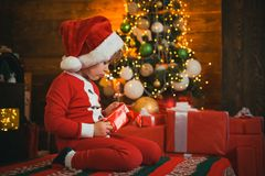 Family holiday. Boy cute child cheerful mood play near christmas tree. Merry and bright christmas. Lovely baby enjoy royalty free stock images