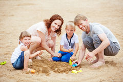 Family holiday with children on beach Royalty Free Stock Image