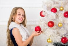 Family holiday concept. Girl velvet dress feel festive near christmas tree. Spread christmas cheer. Kid happy because. Holiday season arrives. Winter holiday royalty free stock photo