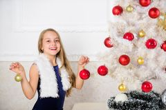 Family holiday concept. Girl velvet dress feel festive near christmas tree. Very special time of year. Spread christmas. Cheer. Kid happy because holiday season stock image