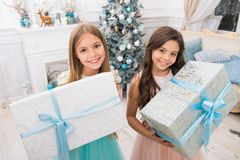 Family holiday. Cute little children girl with xmas present. happy little girls sisters celebrate winter holiday. Christmas time. happy new year. delivery stock photography