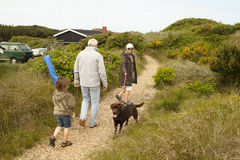 Family holiday in Denmark. Family vacation in denmark, walk with the dog and son north sea beach in denmark, dunes in the background Stock Photos