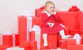 Family holiday. Little baby girl play near pile of gift boxes. Gifts for child first christmas. Celebrate first. Christmas. Christmas gifts for toddler. Baby royalty free stock photos
