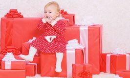 Family holiday. Little baby girl play near pile of gift boxes. Gifts for child first christmas. Celebrate first. Christmas. Christmas gifts for toddler. Baby stock images