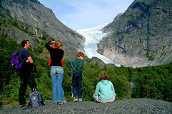 Family holiday in Norway. Family admiring glacier in Norway royalty free stock image