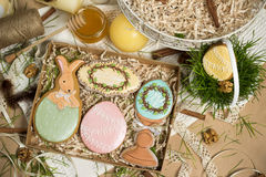 Family holiday present box , easter honey-cakes, celebration spring design. Happy family holiday, presents in box , easter honey-cakes, gingerbread in form of royalty free stock image