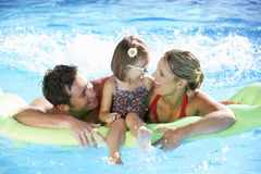 Family On Holiday In Swimming Pool Stock Images