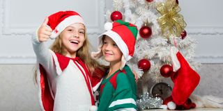 Family holiday tradition. Children cheerful celebrate christmas. Kids christmas costumes santa and elf. Winter. Masquerade concept. Siblings ready celebrate stock photography