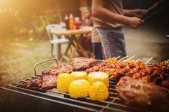 Family holiday vacation barbecue party. Family holiday vacation barbecue party on weekends, Happiness between parents, children and grandparents stock images